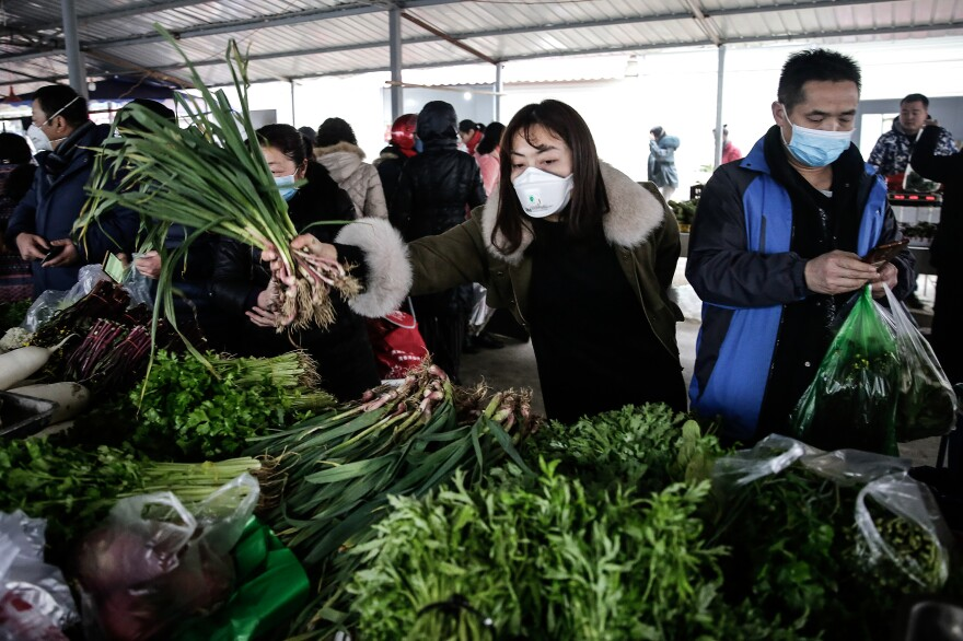 In Wuhan, China, and other parts of East Asia, wearing masks in public has been commonplace since the SARS outbreak in the early 2000s. This photo was taken on January 23, about a week before China called on citizens to wear masks as a way to stem the spread of the novel coronavirus.
