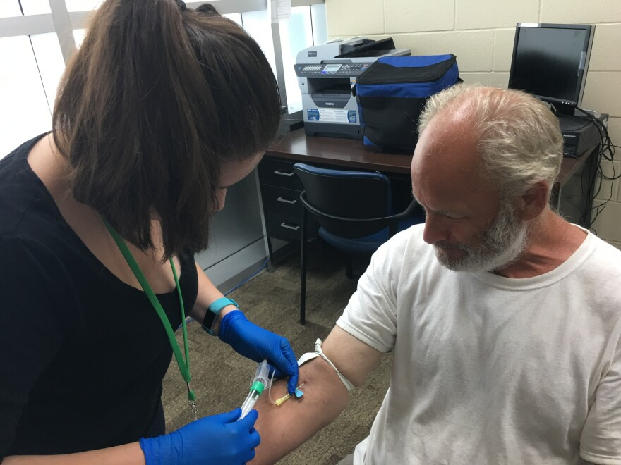 James Harrison gets a free blood test from Michelle Mutchler with the San Antonio Metropolitan Health District. The test checks for a dormant tuberculosis infection that hasn't produced symptoms, but could flare into an active state and become contagious.