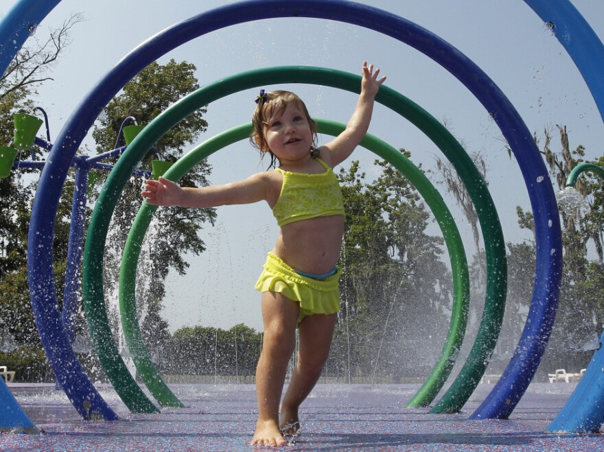 Alivia Parker, 21 months at the time, ran through circles of spraying water on a hot day in Montgomery, Ala., last June. She was wearing sunscreen with an SPF of 100, a rating that won't be allowed much longer.