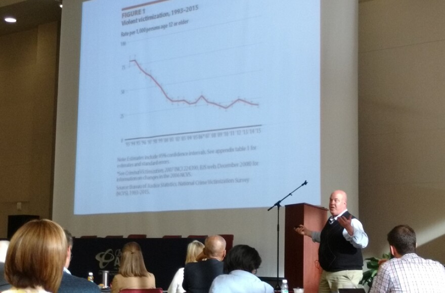 Criminologist Michael Turner of UNC Charlotte showed a slide about the decline in violent crime over the past two decades.