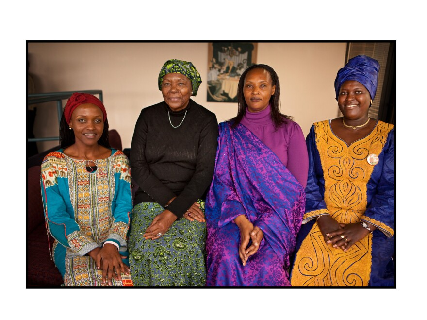 """""""Its a new Rwanda,"""" says Immy Kamarade (second from right), who says women today have access to education, to open an account and to land ownership."""