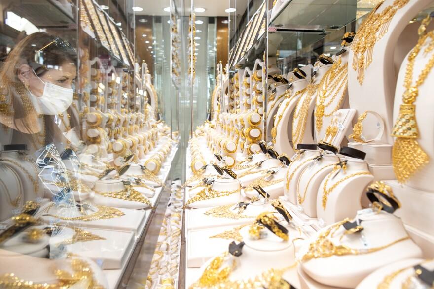 Israeli tourist Ilanit Zighelboim looks at jewelry in Dubai's gold souk last month.
