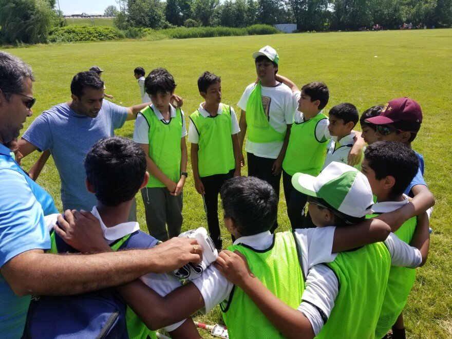 Coach Shaheer Mohammed encourages his team from Lexington, Mass. after a difficult loss.