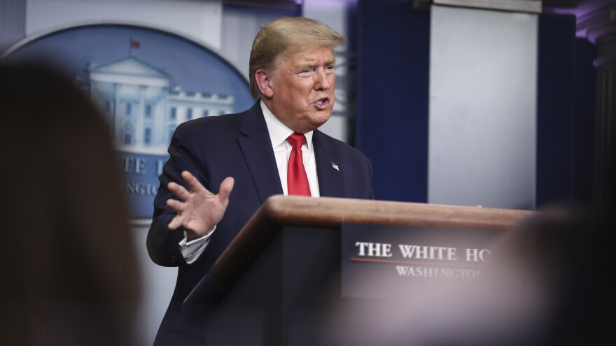President Trump has explained his reluctance to use the Defense Production Act by likening it to a government takeover of companies.