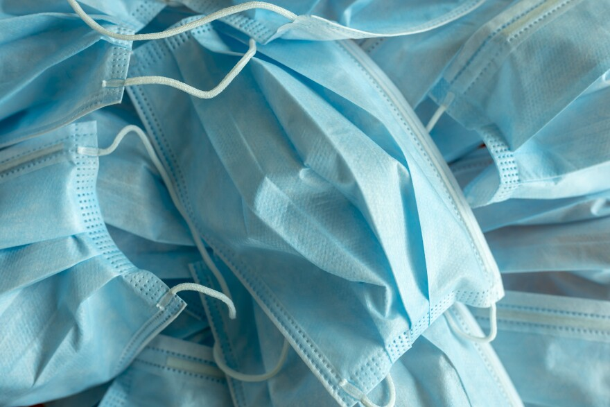 Photo of a pile of blue surgical masks