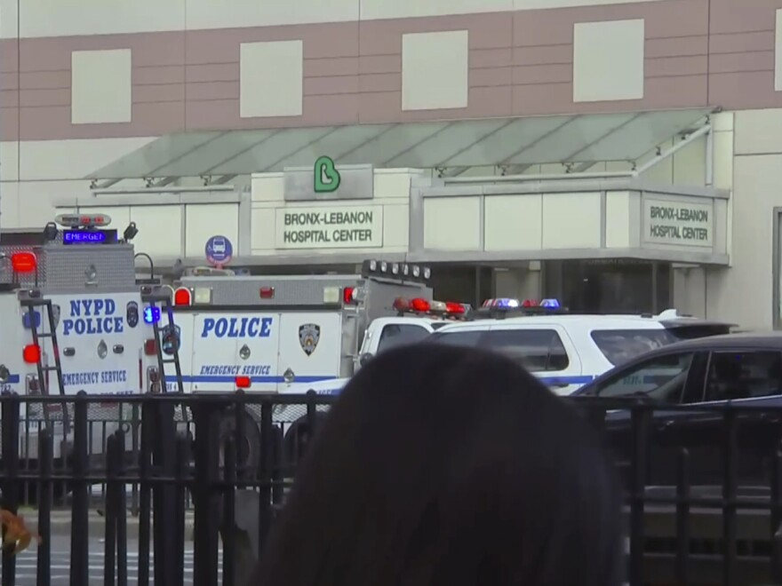 Emergency personnel converge on Bronx-Lebanon Hospital in New York, after a gunman opened fire there on Friday.