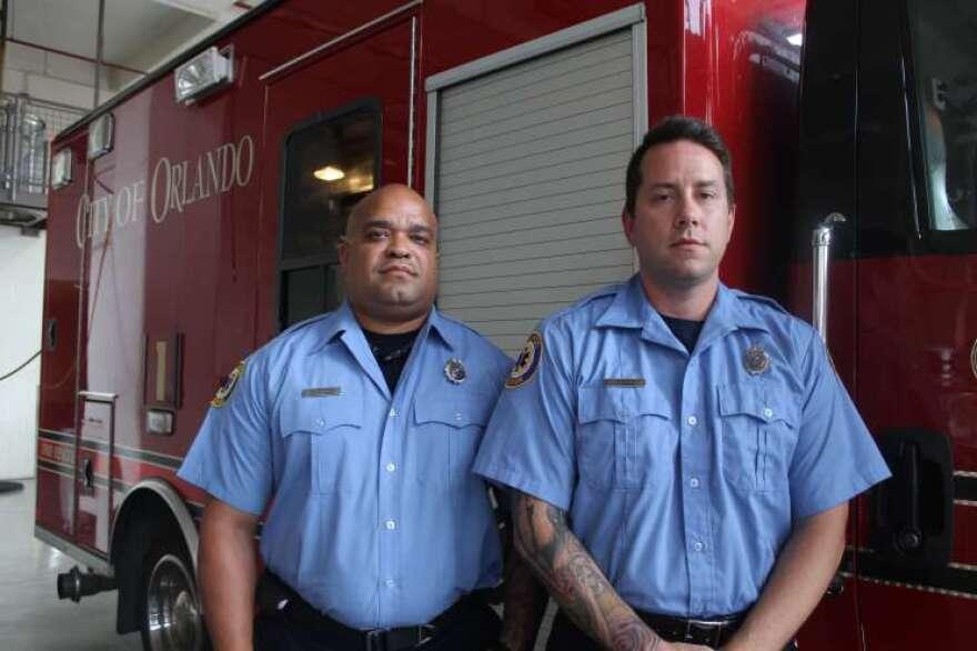 Orlando Fire Department's Carlos Tavarez, left, and Joshua Granada.