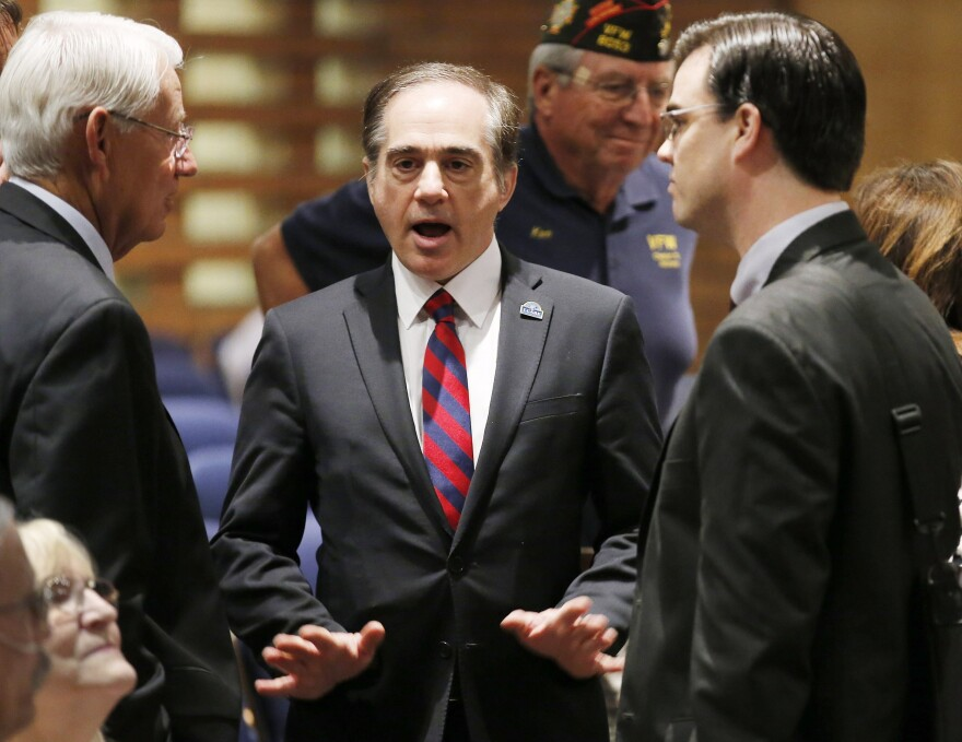 David Shulkin (center), the U.S. Department of Veterans Affairs undersecretary of health, talks with attendees in July prior to testifying at a Senate Veterans' Affairs Committee hearing in Gilbert, Ariz. Donald Trump has selected Shulkin to lead the agency.