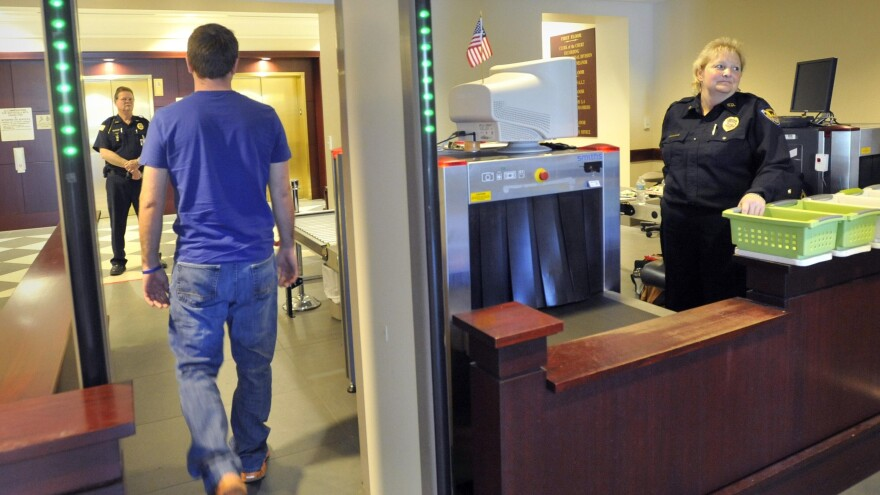 Walk-through metal detectors, like this one at the Clay County Courthouses, will soon be coming to Duval Conty public high schools.