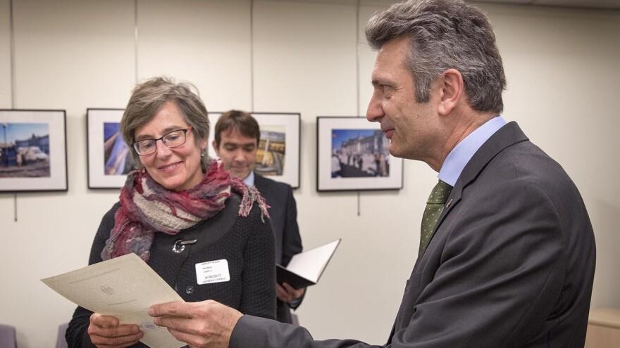 Linda Heuman, 53, receives her certificate of German citizenship from the German consul general in Boston, Ralf Horlemann.