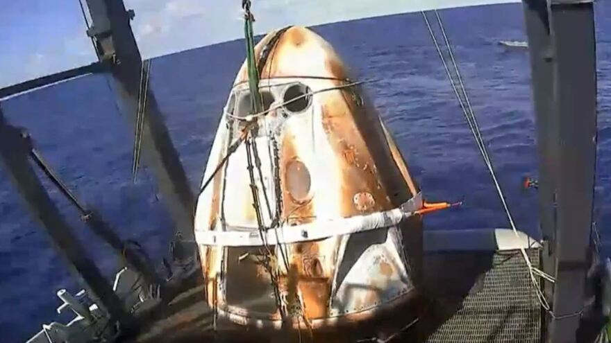 The Crew Dragon capsule was fished out of the Atlantic Ocean off the Florida coast shortly before 10 a.m. ET Friday, with its surface bearing the scorch marks of its fiery re-entry.