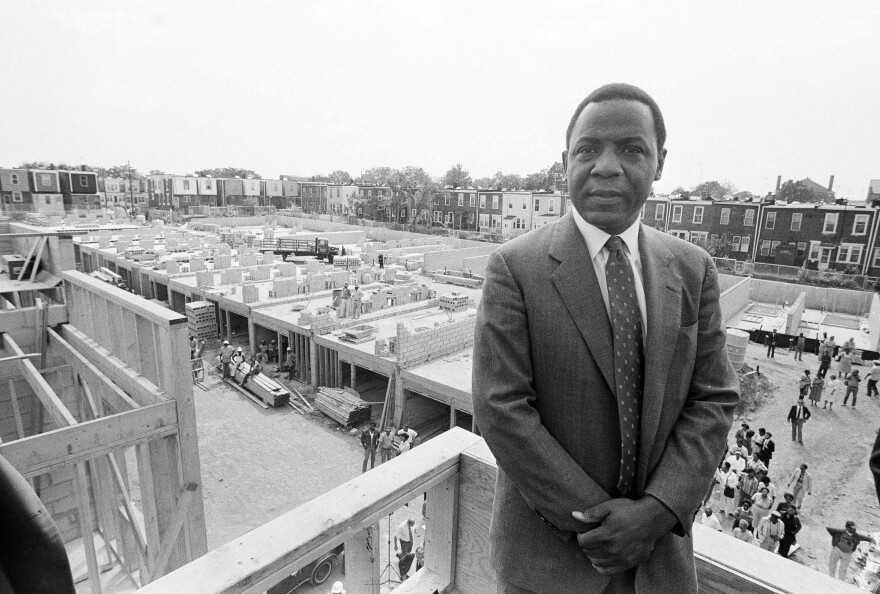 Philadelphia Mayor Wilson Goode stands on the roof of a newly constructed home, Sept. 17, 1985, on the site of the deadly battle with the group MOVE. Homeowners burned out as a result of the police siege of the MOVE headquarters watched the rebuilding process with skepticism.