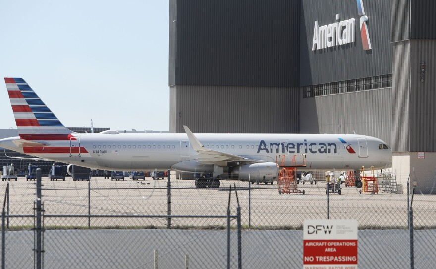 An American Airlines plane sits parked at the Dallas/Fort Worth International Airport.
