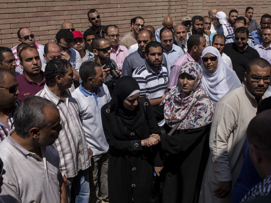 Mourners attend the funeral of Ammar Badie, son of the Muslim Brotherhood's Supreme Guide, at the Katameya cemetery in the New Cairo district on Sunday. Badie was killed in clashes with security forces.