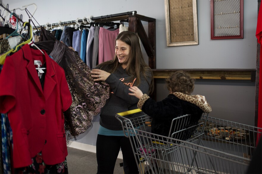 Melanie Robinson looks through clothes while shopping at the Blessed Threads Thrift Shop and Resource Center in Granite City.