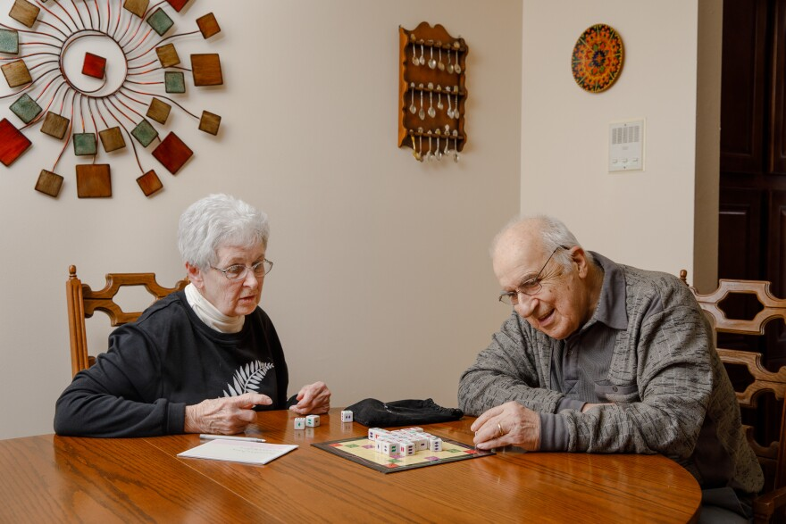 George Berzsenyi and his wife, Kay, of 54 years, play a board game on the dining room table of their Shorewood, Wis., home.