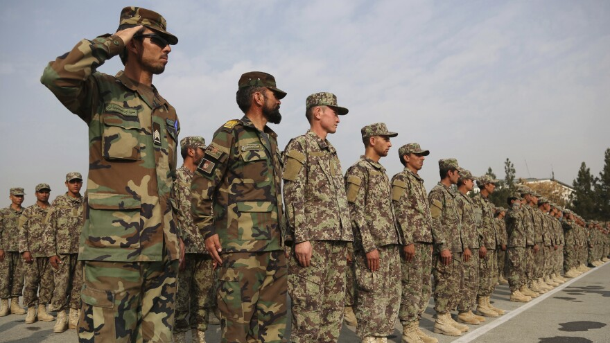 "Afghan cadets attend a graduation ceremony at the Afghan Military Academy in Kabul. Saturday's ""insider attack"" is the third time an Afghan soldier has killed an American counterpart this year."