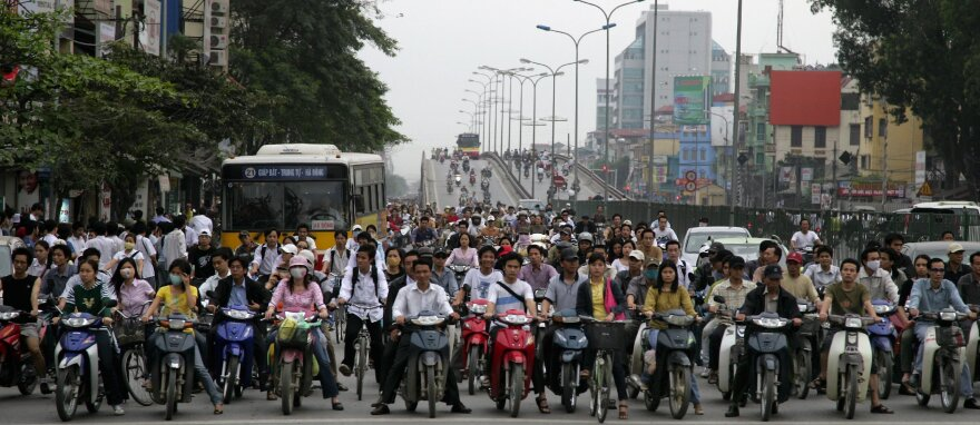 They'd better get out of the way: A Hanoi street scene.