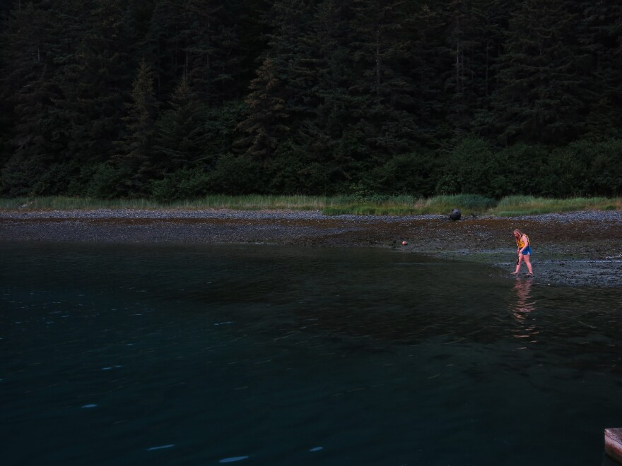 Arete student Danae Sollie takes a brave dip in the chilly waters of the bay.