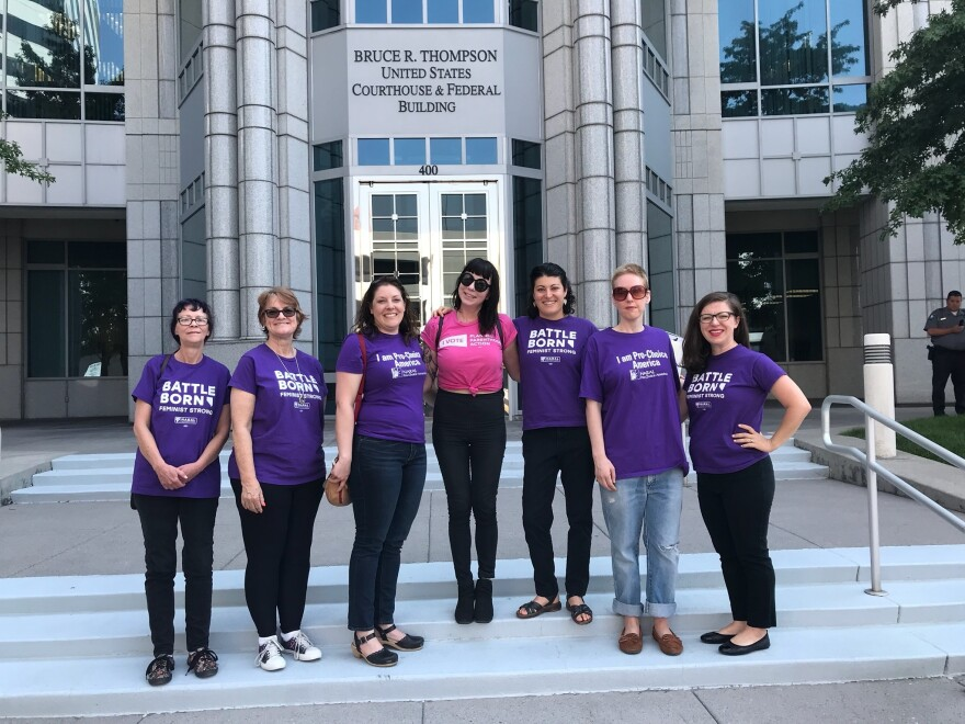 Activists from NARAL Pro-Choice America stand outside the office of GOP Sen. Dean Heller in Reno, Nev. Heller is facing a tough re-election bid in a state that voted for Hillary Clinton in 2016, and activists on the left are putting pressure on him to oppose President Trump's Supreme Court nominee.