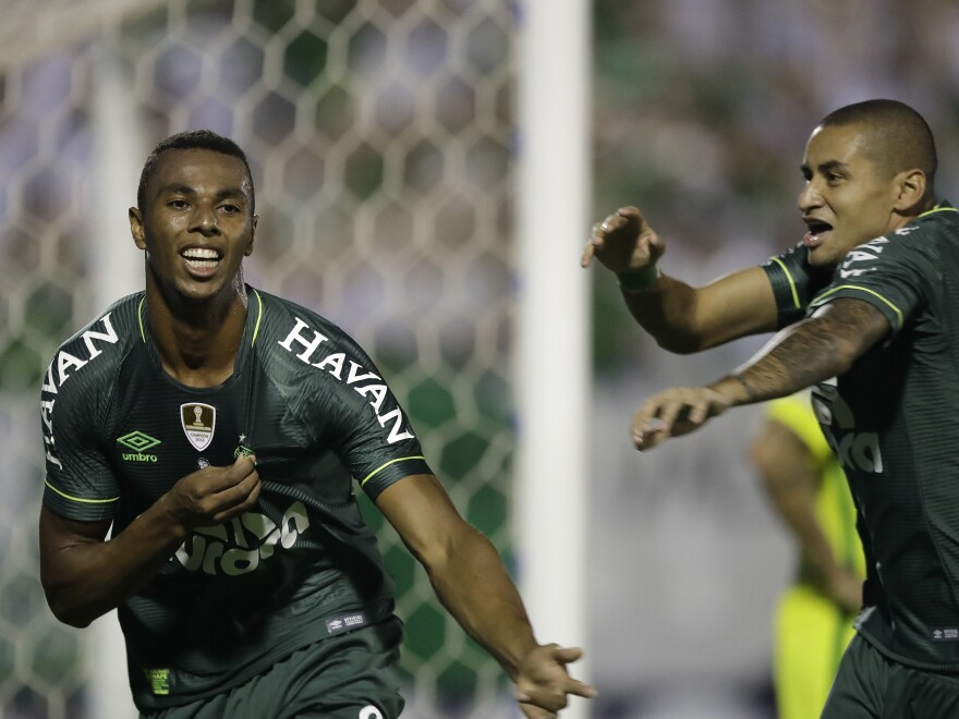Luiz Otávio of Brazil's Chapecoense (left) celebrates with teammate Wellington Paulista after scoring against Colombia's Atlético Nacional in April. Chapecoense has a chance at another title — that of the Recopa Sudamericana — when it plays Atlético again in the second leg of the final this week.