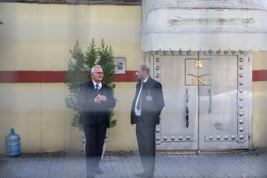 Officials stand outside the Saudi consulate in Istanbul, where Saudi journalist Jamal Khashoggi was last seen alive.