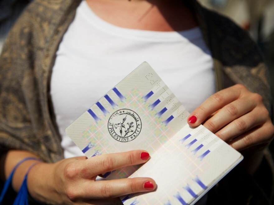 A Dutch student studying at Birzeit University had her passport stamped in Ramallah by artist Khaled Jarrar. She likened having this stamp to having one from Checkpoint Charlie, the famous crossing point between East and West Berlin. It's not a valid passport stamp, but a statement in support of a U.N. bid.