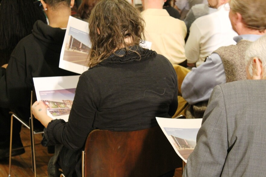 Attendees at a January 11, 2017 committee hearing on a proposed tax increase for MetroLink expansion look at renderings of a proposed stop along the line.