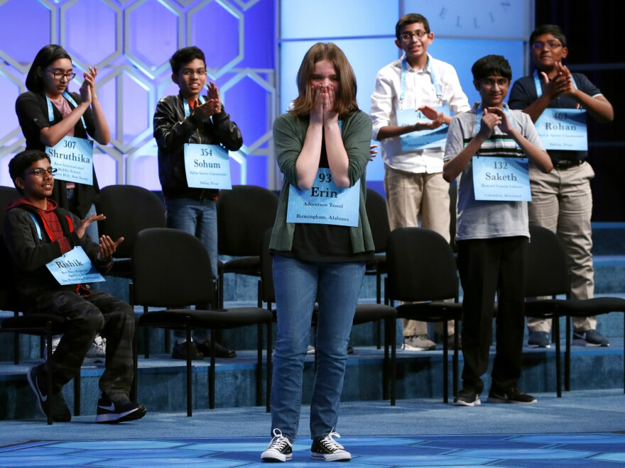 "The Scripps National Spelling Bee is canceling its 2020 national finals, citing ""uncertainty around when public gatherings will be possible or advisable."" Here, Erin Howard, center, is cheered by her fellow co-champions during last year's finals in Oxon Hill, Md."