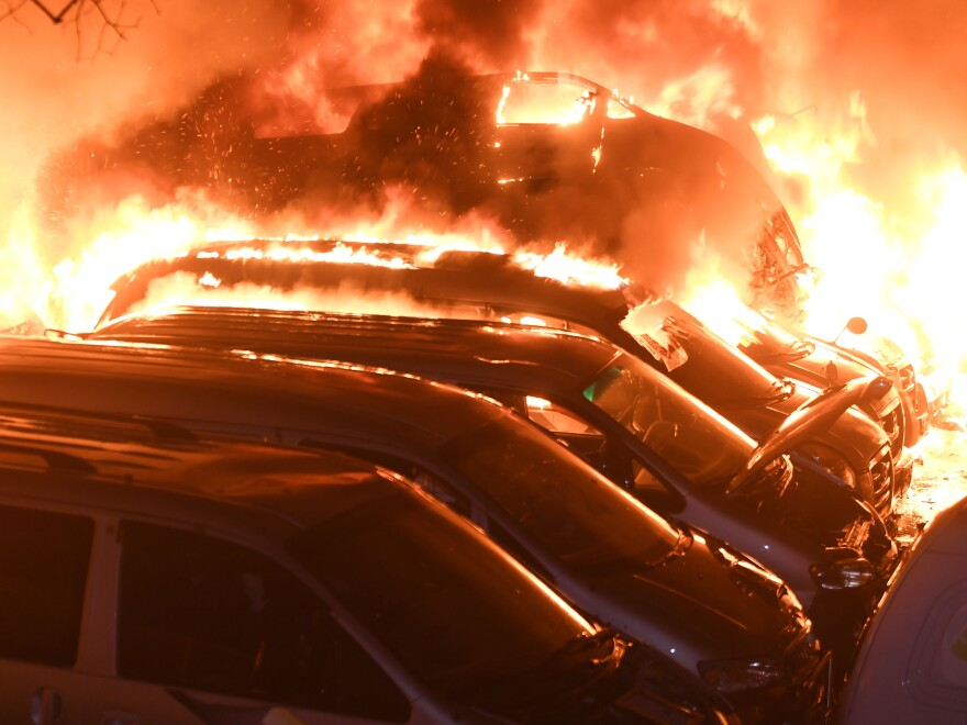 Vehicles burn in Sokcho, South Korea, part of the damage from the worst wildfires the country has seen in years.