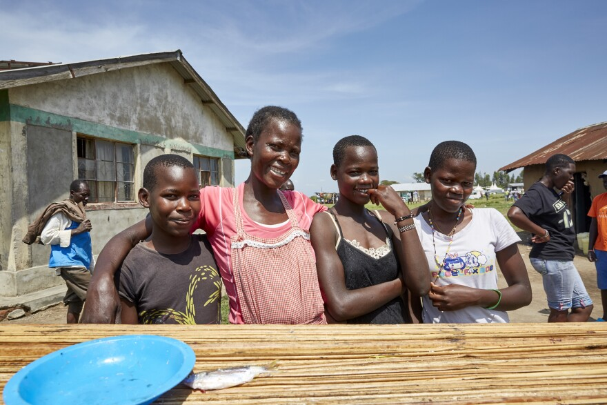 """Naomy Akoth with some of her children. When her boat was grounded, she says, """"I was very discouraged. Because the money I was getting ... I was using to pay for my firstborn's school fees."""""""