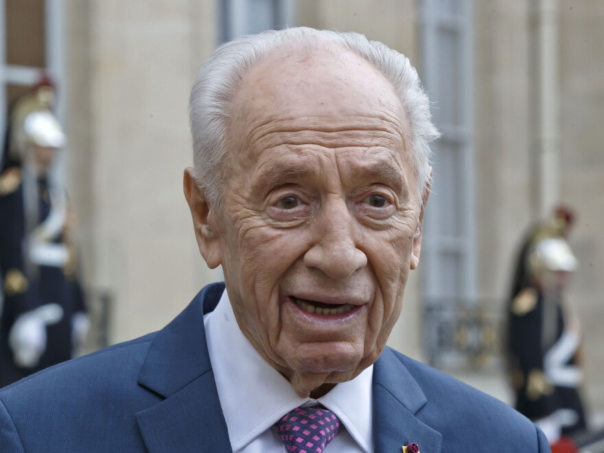 Former Israeli President Shimon Peres talks to the media after a meeting in Paris in March. Peres turned 93 last month.