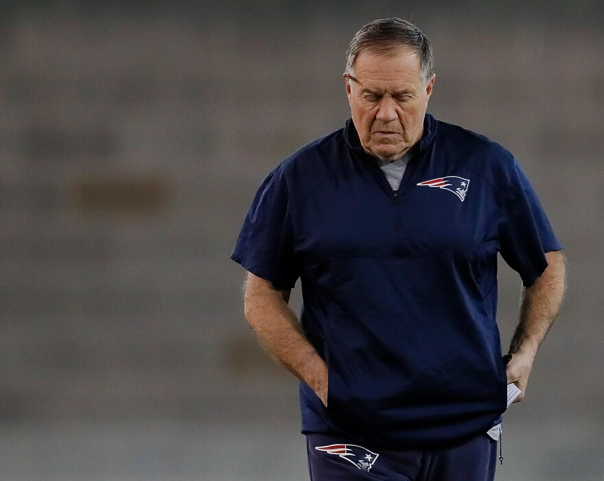 New England Patriots head coach Bill Belichick walks the field during Super Bowl practice on Feb. 1, 2019.