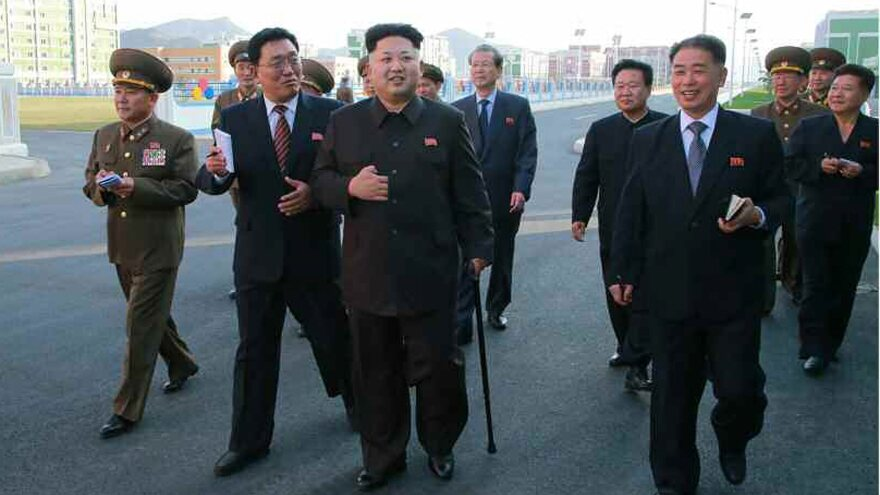 A photo released Monday by the <em>Rodong Sinmun,</em> newspaper of the ruling Workers' Party, shows North Korean leader Kim Jong Un walking with a cane as he visits a residential area in Pyongyang.