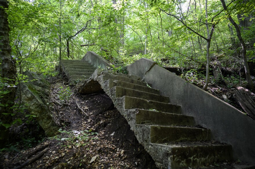 Visitors once climbed this concrete staircase built into the hillside to reach clubhouses along the bluff. Hikers now descend a set of wooden stairs to a trail along the Meramec.