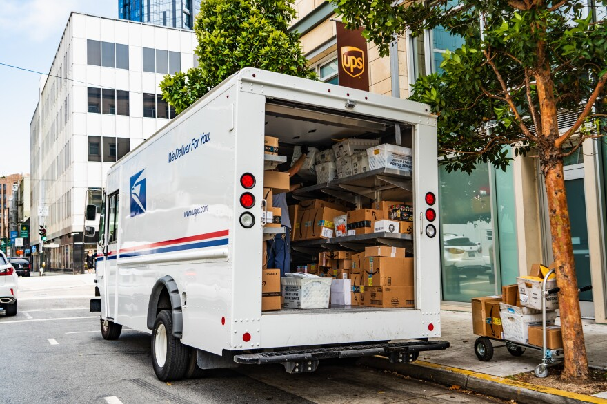 Postal workers are seeing tons of packages come in this holiday season.