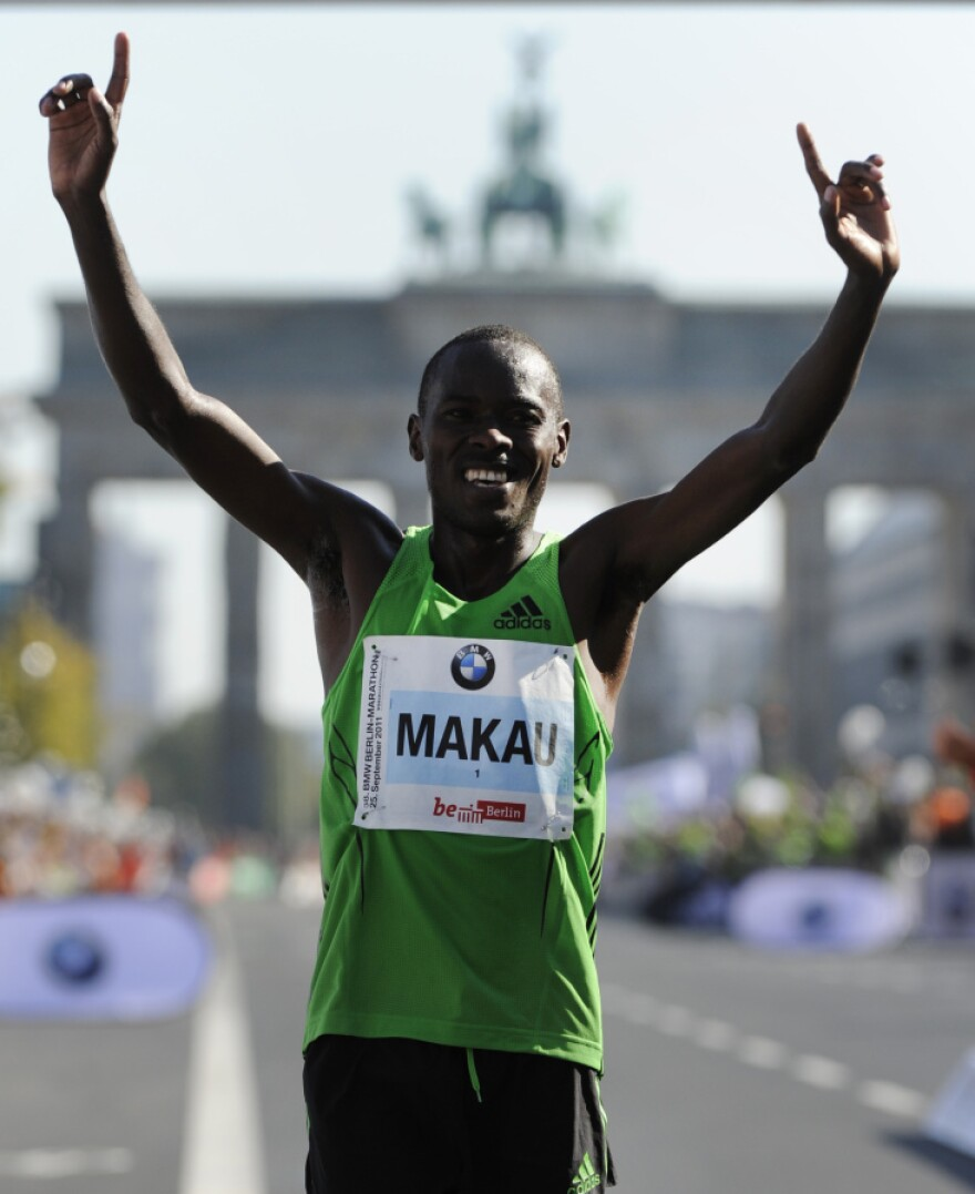 Patrick Makau of Kenya celebrates in front of Berlin's Brandenburg Gate after setting a new world record for the marathon.