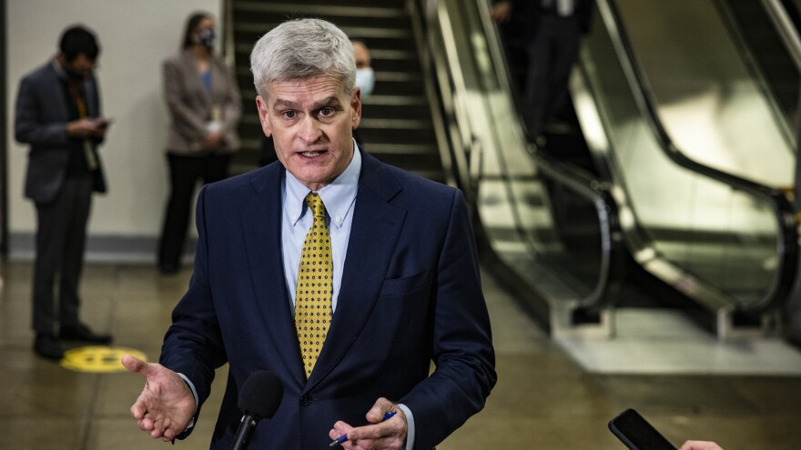 Sen. Bill Cassidy, seen talking to reporters on his way to the fourth day of the Senate impeachment trial, has been censured by the Louisiana GOP for his vote to convict Trump.