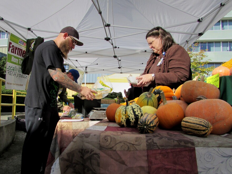 Air Force veteran Sean Michael Dalgarn works the Growing Veterans farm stand at the VA Hospital in Seattle. The group's members learn to farm and then sell its harvest here once a week through December.