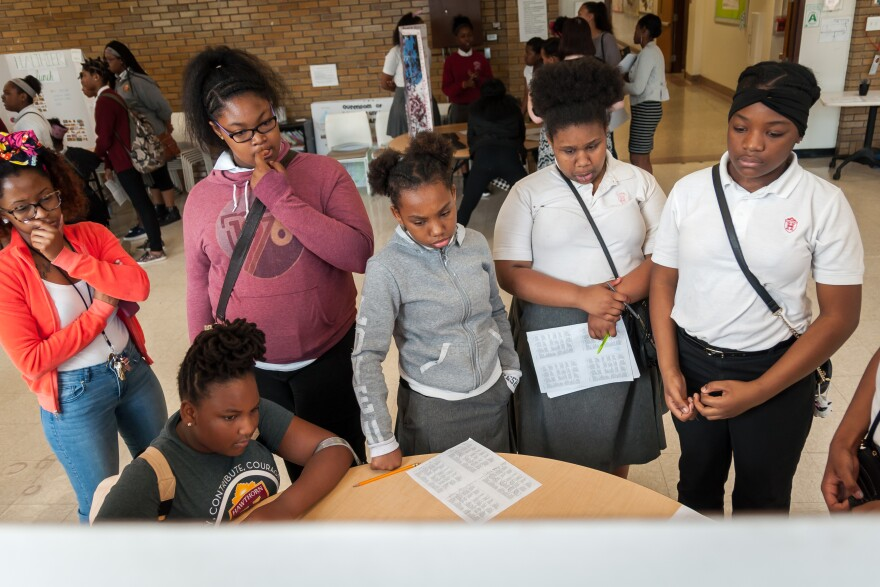 Students at Hawthorn Leadership School for Girls watch classmates' capstone project earlier on May 12, 2017.