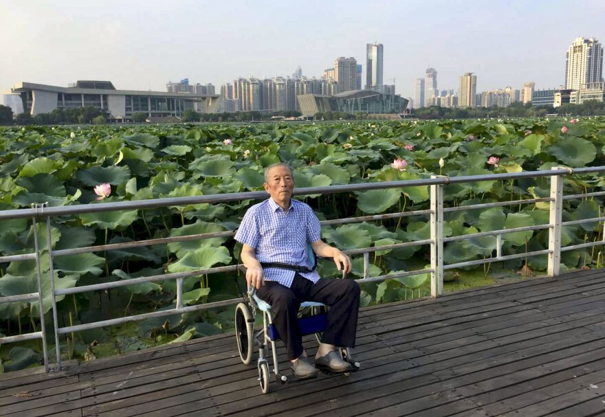 Zhang Lifa, the father of Zhang Hai, in a Wuhan park last year. He spent several years participating in China's nuclear weapons program in the 1960s and suffered life long health consequences from radiation exposure as a result. He died of the coronavirus this year.