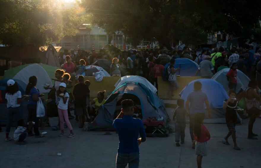 Asylum seekers waited in line to get a meal provided by Team Brownsville near the Gateway International Bridge in Matamoros, Mexico in 2019.