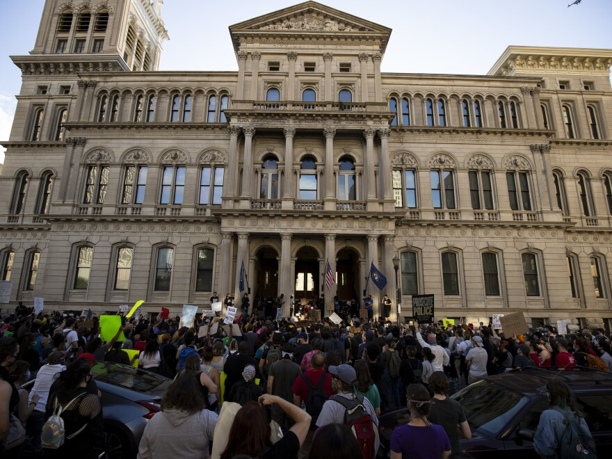 Demonstrators gather outside City Hall in Louisville, Ky., on May 29 to protest of police violence.