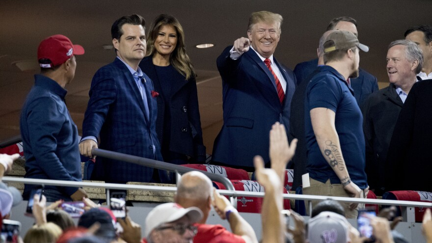 President Donald Trump and first lady Melania Trump, third from left, arrive for Game 5 of the World Series. Also pictured are Rep. Matt Gaetz, R-Fla., second from left, and Rep. Mark Meadows, R-N.C, right.