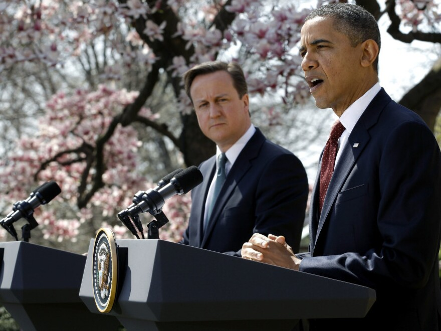 President Obama and British Prime Minister David Cameron during their news conference this afternoon in the Rose Garden of the White House.