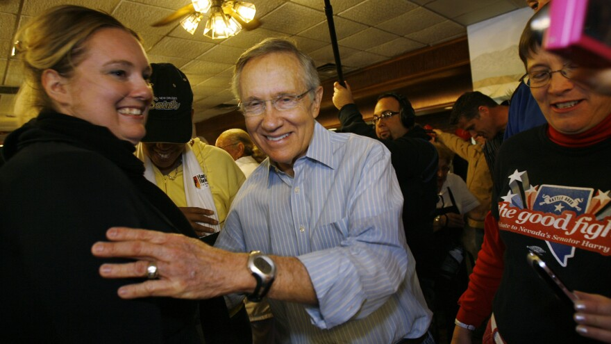 Senate Minority Leader Harry Reid greets supporters in his hometown of Searchlight, Nev., during a campaign stop in 2010.