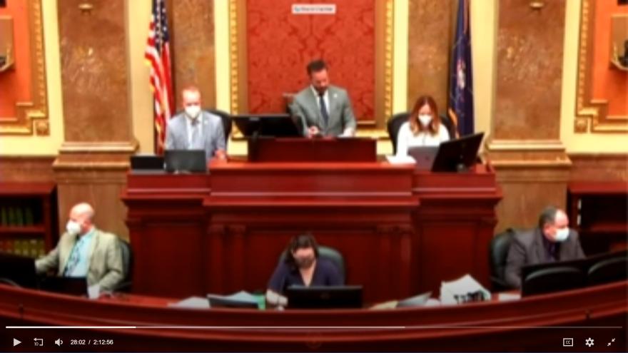 Screenshot of lawmakers wearing masks at dais.