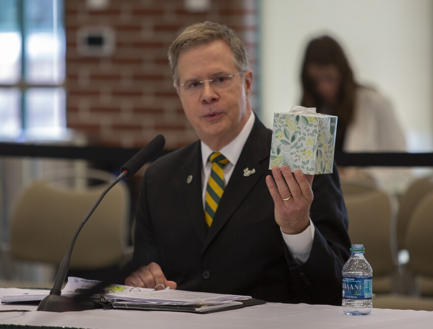 Former University of Mississippi Chancellor Jeffrey Vitter uses a tissue box to make a point about diversity to USF Trustees Friday.