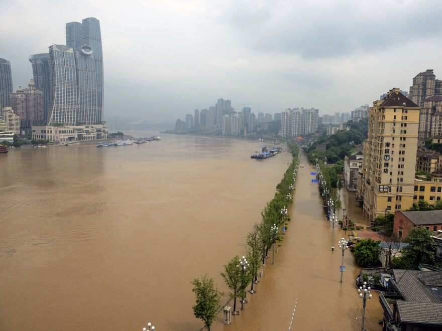 A main road in China, is shown inundated with flood waters, on Wednesday.