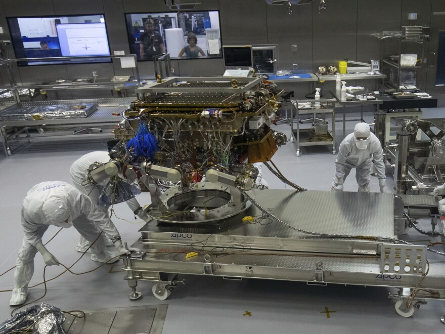 A team prepare the European Space Agency's ExoMars rover to leave Airbus plant in Stevenage, England, in August 2019. The rover's launch is now delayed to 2022.